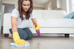 Woman kneeling wiping the floor